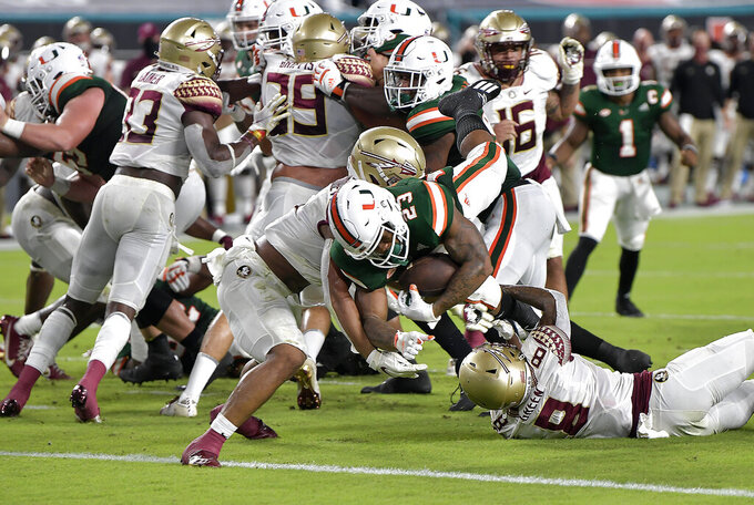 Miami running back Cam'Ron Harris (23) scores a touchdown against Florida State during the first half of an NCAA college football game, Saturday, Sept. 26, 2020, in Miami Gardens, Fla. (Michael Laughlin/South Florida Sun-Sentinel via AP)