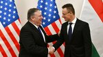 Hungarian Minister of Foreign Affairs and Trade Peter Szijjarto, right, shakes hands with US Secretary of State Mike Pompeo in the ministry in Budapest, Hungary, Monday, February 11, 2019. Pompeo is on an official visit to Hungary. (Zsolt Szigetvary/MTI via AP)