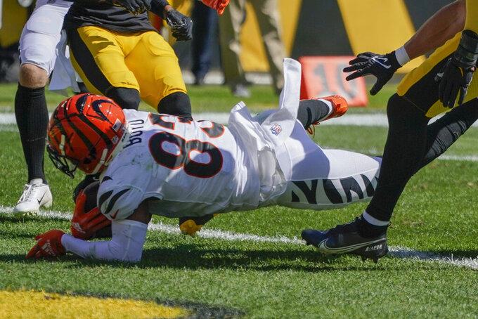 Cincinnati Bengals wide receiver Tyler Boyd (83) dives past Pittsburgh Steelers inside linebacker Joe Schobert for a touchdown during the first half an NFL football game, Sunday, Sept. 26, 2021, in Pittsburgh. (AP Photo/Gene J. Puskar)