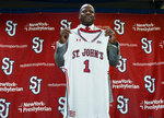 Mike Anderson holds up a jersey after being introduced as the new St. John's men's basketball coach during a news conference, Friday, April 19, 2019, at Madison Square Garden in New York. Anderson was hired as Red Storm coach on Friday after he was fired by Arkansas in March 2019. (Craig Ruttle/Newsday via AP)