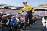 This March 8, 2020 photo shows Brad Keselowski during driver introductions prior to the NASCAR Cup Series auto race at Phoenix Raceway in Avondale, Ariz. Keselowski will start on the pole when the NASCAR season resumes Sunday, May 17, 2020 in Darlington, S.C. The 2012 Cup champion earned the top starting spot through a random draw. (AP Photo/Ralph Freso)