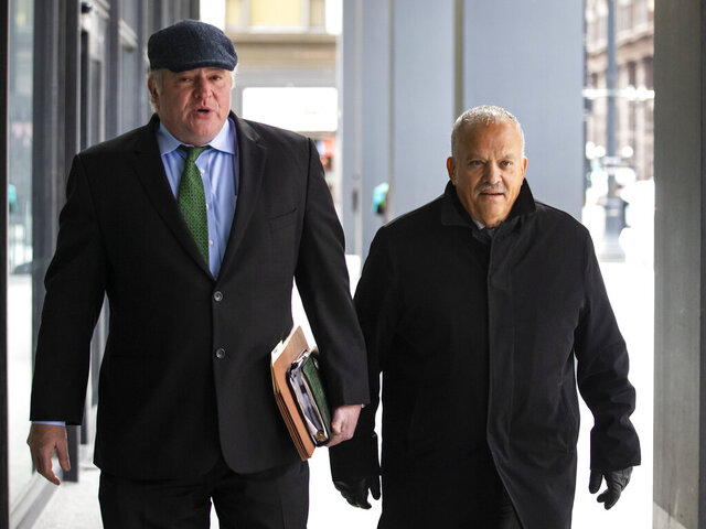 Former state Rep. Luis Arroyo, right, walks with his defense attorney, Michael Gillespie, into the Dirksen Federal Courthouse for arraignment, Tuesday, Feb. 4, 2020. (Ashlee Rezin Garcia/Chicago Sun-Times via AP)