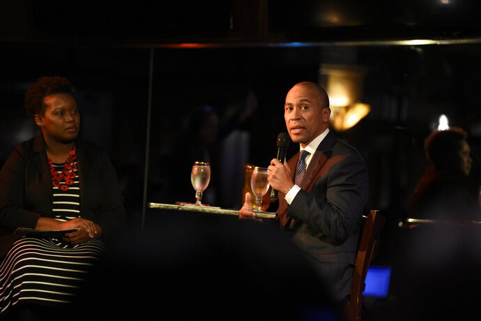 Democratic presidential hopeful and former Massachusetts Gov. Deval Patrick, right, fields questions during a campaign event at a restaurant, Tuesday, Nov. 19, 2019, in Columbia, S.C. (AP Photo/Meg Kinnard)