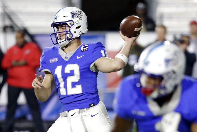Middle Tennessee quarterback Brent Stockstill (12) passes against Western Kentucky in the first half of an NCAA college football game Friday, Nov. 2, 2018, in Murfreesboro, Tenn. (AP Photo/Mark Humphrey)