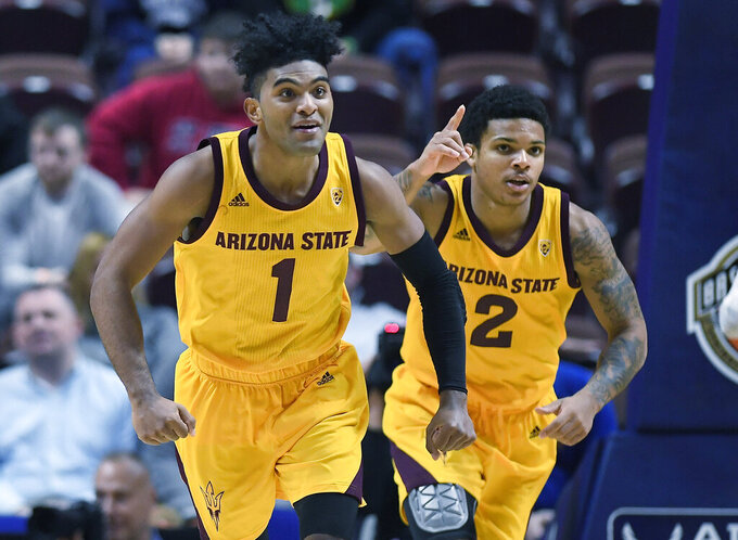 Arizona State's Remy Martin, left, and Arizona State's Rob Edwards celebrate a basket during the second half of an NCAA college basketball game against St. John's, Saturday, Nov. 23, 2019, in Uncasville, Conn. (AP Photo/Jessica Hill)