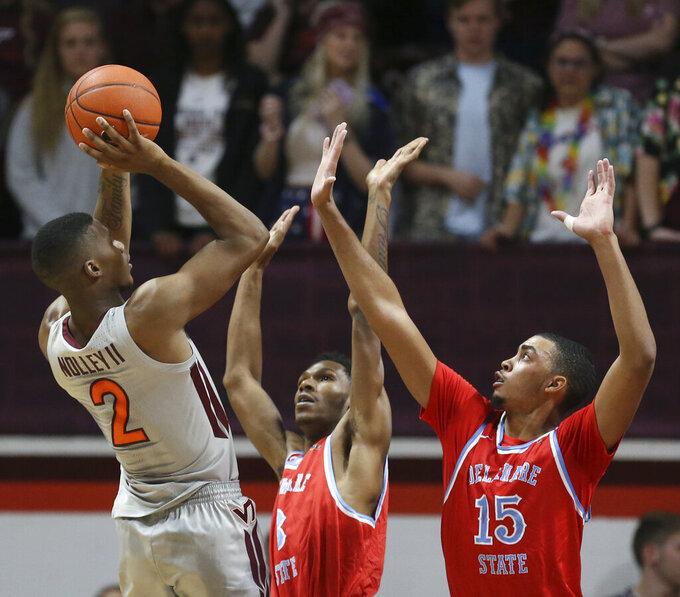 Landers Nolley II (2) of Virginia Tech shoots over Delaware Stare defenders Lance Singh (3) and Ameer Bennett (15) in the first half of an NCAA college basketball game in Blacksburg Va. Wednesday, Nov. 20 2019. (Matt Gentry/The Roanoke Times via AP)