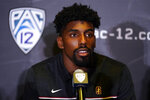 Stanford defensive end Thomas Booker fields questions during the Pac-12 Conference NCAA college football Media Day Tuesday, July 27, 2021, in Los Angeles. (AP Photo/Marcio Jose Sanchez)