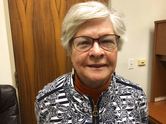 Kate Stanley, interim chairwoman of the Democratic Party of Hawaii, poses for a photo in Honolulu on Thursday, Feb. 20, 2020. Democratic Party of Hawaii members can use mail-in ballots to select their choice for presidential nominee this year to avoid the long lines of past party caucuses. (AP Photo/Audrey McAvoy)