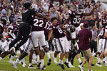 Mississippi State players celebrate their 35-34 win over Louisiana Tech in their NCAA college football game in Starkville, Miss., Saturday, Sept. 4, 2021. (AP Photo/Rogelio V. Solis)