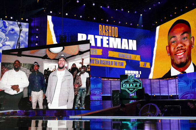Images of Minnesota wide receiver Rashod Bateman are displayed on stage after he was chosen by the Baltimore Ravens with the 27th pick in the first round of the NFL football draft Thursday April 29, 2021, in Cleveland. (AP Photo/Tony Dejak)
