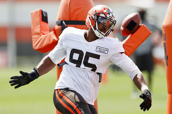 Cleveland Browns defensive end Myles Garrett runs through a drill during practice at the NFL football team's training facility Monday, Aug. 24, 2020, in Berea, Ohio. (AP Photo/Ron Schwane)