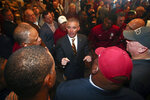 FILE - In this Sunday, Dec. 8, 2019, file photo, new Florida State NCAA college football head coach Mike Norvell talks to football staffers after a news conference, in Tallahassee, Fla. Norvell is taking over a Seminoles program that has struggled while he was helping to build Memphis into a Group of Five power. Florida State got in three practices before the new coronavirus outbreak shut down college sports and upended nearly everything else. (AP Photo/Phil Sears, File)