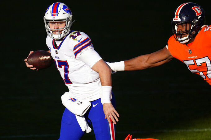 Buffalo Bills quarterback Josh Allen gets away from Denver Broncos defensive end DeMarcus Walker during the first half of an NFL football game Saturday, Dec. 19, 2020, in Denver. (AP Photo/Jack Dempsey)
