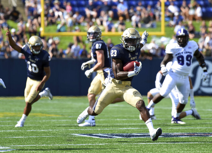 Navy's Myles Fells runs against Holy Cross during an NCAA college football game, Saturday, Aug. 31, 2019, in Annapolis, Md. (Paul W. Gillespie/Capital Gazette via AP)