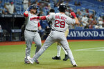 Boston Red Sox's Bobby Dalbec (29) celebrates with Christian Vazquez after Dalbec hit a solo home run off Tampa Bay Rays pitcher Luis Patino during the second inning of a baseball game Monday, Aug. 30, 2021, in St. Petersburg, Fla. (AP Photo/Chris O'Meara)