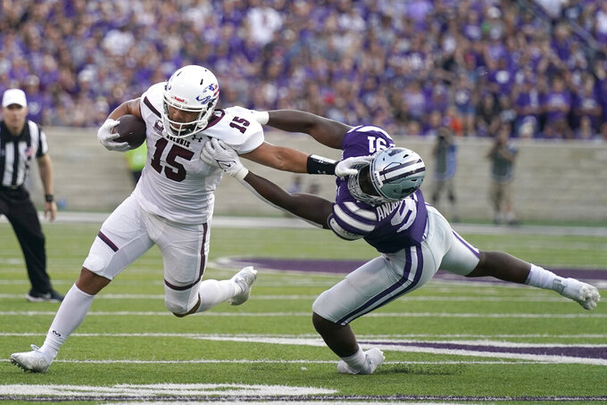 Kansas State defensive end Felix Anudike (91) tackles Southern Illinois running back Javon Williams Jr. (15) during the first half of an NCAA college football game, Saturday, Sept. 11, 2021, in Manhattan, Kan. (AP Photo/Charlie Riedel)