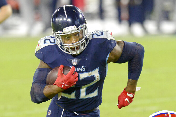 Tennessee Titans running back Derrick Henry (22) carries the ball against the Buffalo Bills in the second half of an NFL football game Tuesday, Oct. 13, 2020, in Nashville, Tenn. (AP Photo/Mark Zaleski)