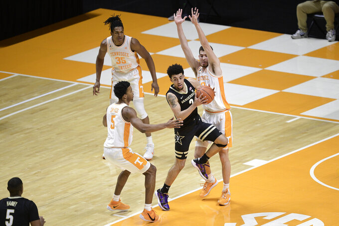Tennessee's Josiah-Jordan James (5) and John Fulkerson (10) double team Vanderbilt guard Scotty Pippen Jr. (2)  during an NCAA college basketball game at Thompson-Boling Arena in Knoxville, Tenn., Saturday, Jan. 16, 2021. (Calvin Mattheis/Knoxville News Sentinel via AP, Pool)
