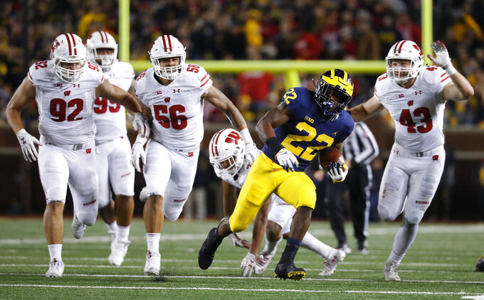 Michigan running back Karan Higdon (22) carries against Wisconsin during the second half of an NCAA college football game in Ann Arbor, Mich., Saturday, Oct. 13, 2018. (AP Photo/Paul Sancya)