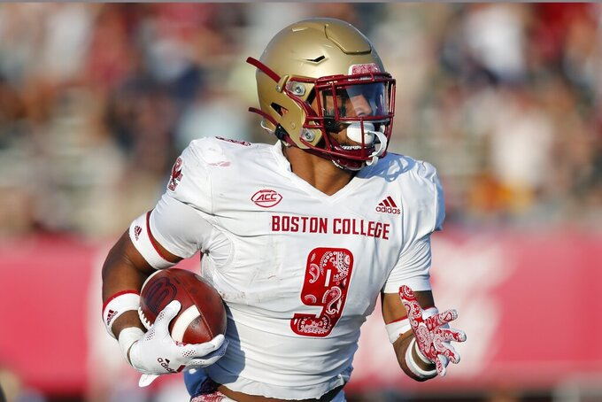 Boston College defensive back Jaiden Woodbey (9) carries a fumble recovery for a touchdown during the second half of an NCAA college football game against Massachusetts, Saturday, Sept. 11, 2021, in Amherst, Mass. (AP Photo/Michael Dwyer)