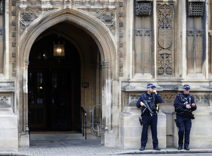 Armed police forces guard the entrance of the Houses of Parliament in London, Monday, Sept. 9, 2019. British Prime Minister Boris Johnson voiced optimism Monday that a new Brexit deal can be reached so Britain leaves the European Union by Oct. 31.(AP Photo/Frank Augstein)