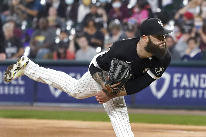 Chicago White Sox starting pitcher Dallas Keuchel follows through on a delivery during the first inning of the team's baseball game against the Los Angeles Angels on Wednesday, Sept. 15, 2021, in Chicago. (AP Photo/Charles Rex Arbogast)
