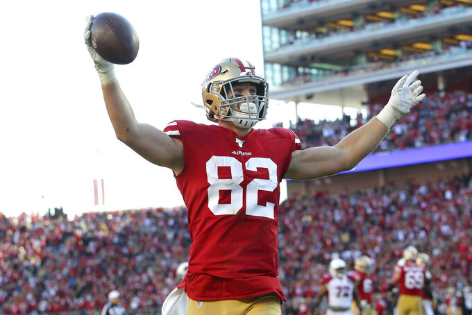 San Francisco 49ers tight end Ross Dwelley (82) celebrates after scoring against the Arizona Cardinals during the second half of an NFL football game in Santa Clara, Calif., Sunday, Nov. 17, 2019. (AP Photo/John Hefti)