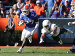 Florida running back Dameon Pierce (27) runs past Idaho defensive lineman Ben Taliulu for yardage during the second half of an NCAA college football game, Saturday, Nov. 17, 2018, in Gainesville, Fla. (AP Photo/John Raoux)