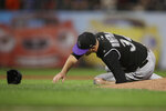 Colorado Rockies' Jeff Hoffman falls on the mound after being hit by a ball batted by San Francisco Giants' Alex Dickerson during the fourth inning of a baseball game Tuesday, Sept. 24, 2019, in San Francisco. Hoffman left the game on a cart. (AP Photo/Ben Margot)