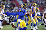 Los Angeles Rams quarterback Brandon Allen (8) looks to throw as Denver Broncos defensive end Dre'Mont Jones (93) during the first half of an NFL preseason football game Saturday, Aug. 24, 2019, in Los Angeles. (AP Photo/Rick Scuteri)
