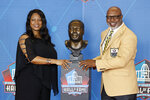 Donnie Shell, right, a member of the Pro Football Hall of Fame Centennial Class, poses with his presenter, April Shell, during the induction ceremony at the Pro Football Hall of Fame, Saturday, Aug. 7, 2021, in Canton, Ohio. (AP Photo/Ron Schwane, Pool)