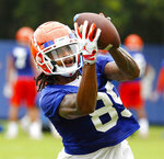 Florida wide receiver Tyrie Cleveland (89) catches a ball as he runs a drill during an NCAA college football practice in Gainesville, Fla., Friday, July 26, 2019. (Brad McClenny/The Gainesville Sun via AP)