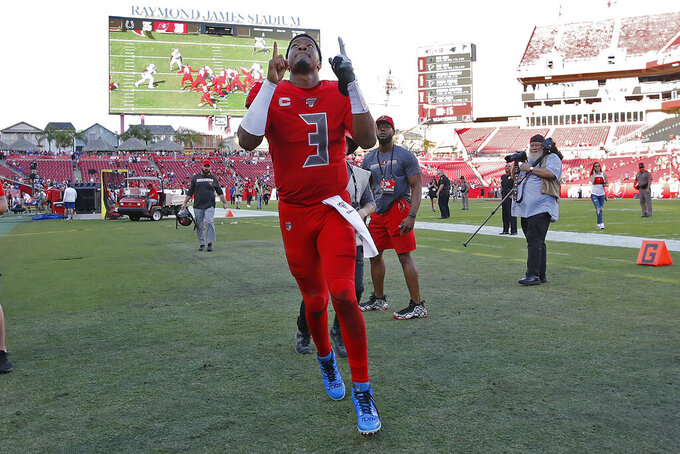 Tampa Bay Buccaneers quarterback Jameis Winston (3) celebrates as he runs off the field after an NFL football game against the Indianapolis Colts Sunday, Dec. 8, 2019, in Tampa, Fla. (AP Photo/Mark LoMoglio)