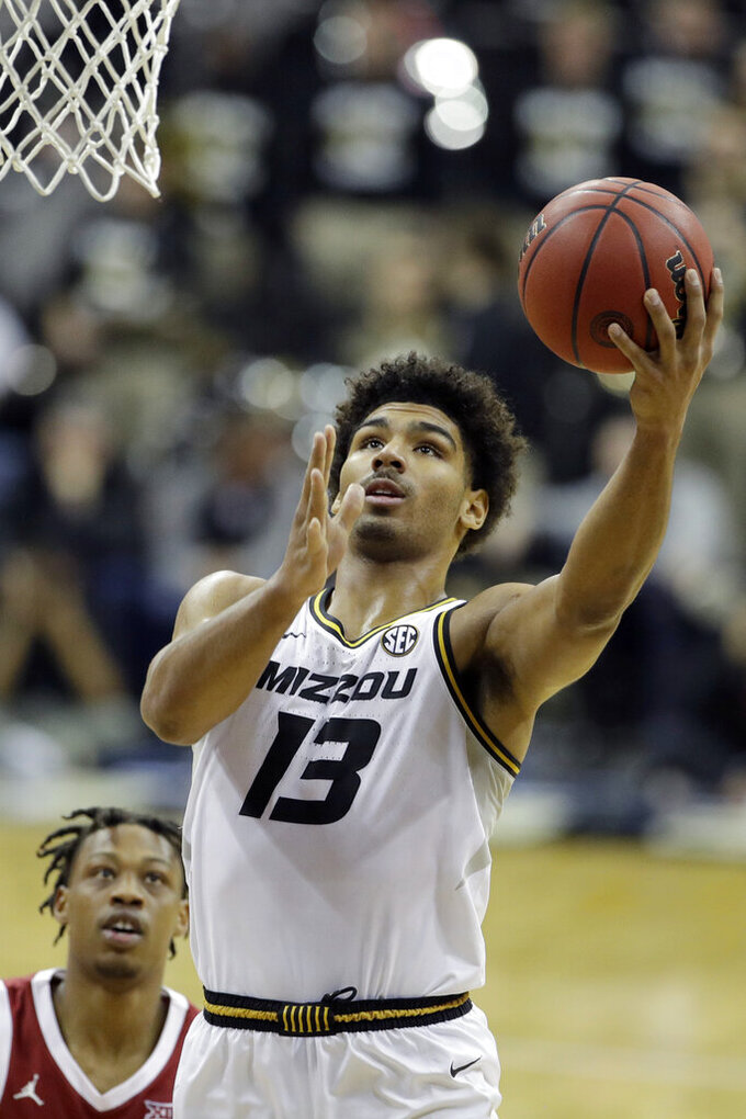 Missouri guard Mark Smith (13) shoots during the first half of an NCAA college basketball game against Oklahoma, Tuesday, Nov. 26, 2019, in Kansas City, Mo. (AP Photo/Charlie Riedel)