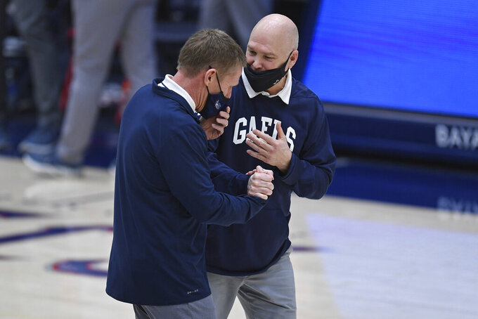 Gonzaga coach Mark Few, left, greets Saint Mary's coach Randy Bennett before an NCAA college basketball game in Moraga, Calif., Saturday, Jan. 16, 2021. (Jose Carlos Fajardo/Bay Area News Group via AP)