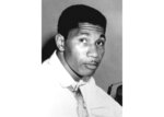 FILE - This Aug. 9, 1955 file photo shows Medgar Evers, serving as state secretary for the NAACP, in Jackson, Miss. The Mississippi home of the slain civil rights leader is one step closer to becoming a national monument. The U.S. House voted Tuesday, May 15, 2018, to pass a bill that would establish the Medgar Evers National Monument in Jackson. The Senate must still vote on the measure filed by Democratic Rep. Bennie Thompson of Mississippi. As Mississippi's first NAACP field secretary, beginning in 1954, Evers organized protests and boycotts to fight segregation. He was assassinated by a white supremacist outside his family's Jackson home in 1963. (AP Photo, File)