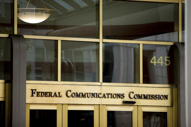 FILE - This June 19, 2015, file photo, shows the Federal Communications Commission building in Washington. The Federal Communications Commission on Friday, Feb. 28, 2020, is proposing about $200 million in fines combined for the four major U.S. phone companies for improperly disclosing customers' real-time location. Location data makes it possible to identify the whereabouts of nearly any phone in the U.S.  (AP Photo/Andrew Harnik, File)