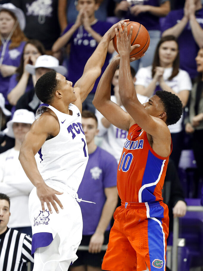 TCU guard Desmond Bane (1) blocks a 3-point basket attempt by Florida guard Noah Locke (10) in the second half of an NCAA college basketball game in Fort Worth, Texas, Saturday, Jan. 26, 2019. (AP Photo/Tony Gutierrez)