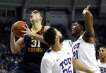 West Virginia forward Logan Routt (31) leaps to the basket for a shot as TCU guard Alex Robinson (25) and center Kevin Samuel (21) defend in the first half of an NCAA college basketball game, Tuesday, Jan. 15, 2019, in Fort Worth, Texas. (AP Photo/Tony Gutierrez)