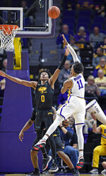 LSU guard Charles Manning Jr. (11) shoots over Maryland-Baltimore County guard Keondre Kennedy (0) during the second half of an NCAA college basketball game Tuesday, Nov. 19, 2019, in Baton Rouge, La. LSU won 77-50. (AP Photo/Bill Feig)
