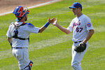 New York Mets catcher Tomás Nido (3) congratulates teammate Seth Lugo (67) after Lugo earned the save in the Mets victory over the Miami Marlins in a baseball game at Citi Field, Sunday, Aug. 9, 2020, in New York. (AP Photo/Kathy Willens)