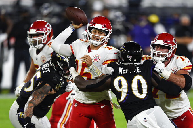 Kansas City Chiefs quarterback Patrick Mahomes (15) throws under pressure by Baltimore Ravens outside linebacker Pernell McPhee (90) during the first half of an NFL football game Monday, Sept. 28, 2020, in Baltimore. (AP Photo/Gail Burton)