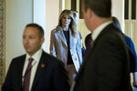 First lady Melania Trump departs a roundtable discussion on the opioid crisis, on Capitol Hill in Washington, Wednesday, Oct. 23, 2019. The first lady marked the first anniversary of the President's signing of the SUPPORT for Patients and Communities Act and it's impact on the country. (AP Photo/Cliff Owen)