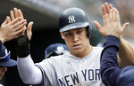 New York Yankees' Aaron Judge celebrates after scoring against the Detroit Tigers on a wild pitch during the seventh inning of the first game of a baseball doubleheader Thursday, Sept. 12, 2019, in Detroit. (AP Photo/Duane Burleson)