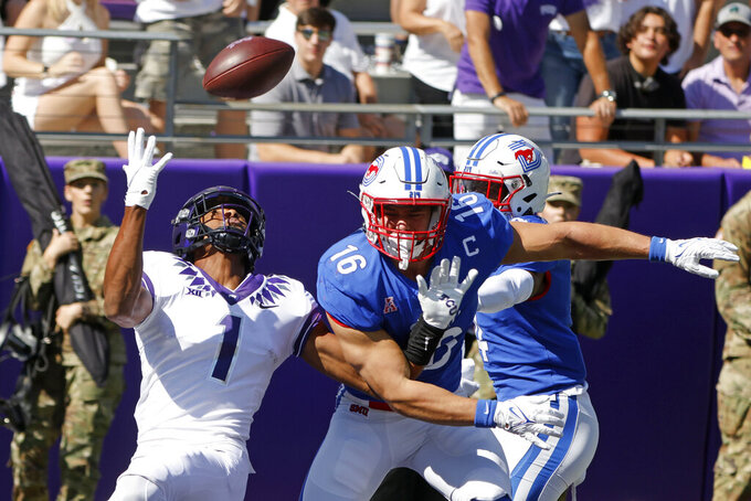 SMU linebacker Trevor Denbow (16) is called for pass interference against TCU wide receiver Quentin Johnston (1) during the first half of an NCAA football game in Fort Worth, Texas, Saturday, Sept. 25, 2021. (AP Photo/Michael Ainsworth)