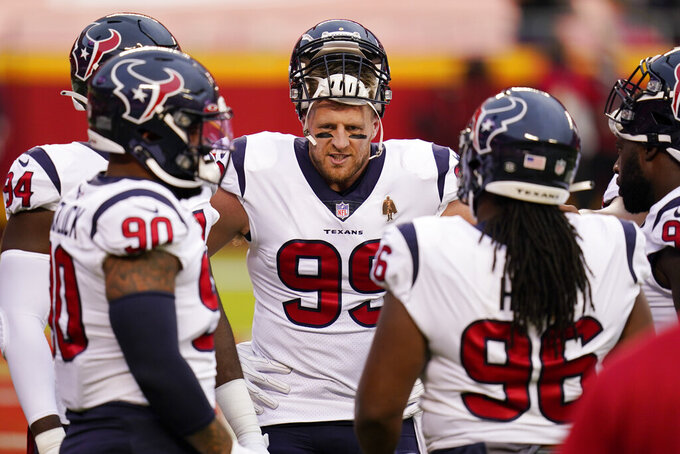 Houston Texans defensive end J.J. Watt (99) talks with teammates before an NFL football game against the Kansas City Chiefs Thursday, Sept. 10, 2020, in Kansas City, Mo. (AP Photo/Jeff Roberson)
