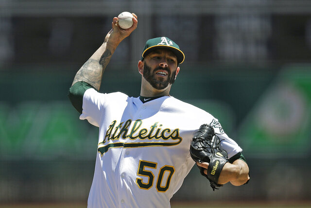 FILE - In this July 28, 2019, file photo, Oakland Athletics pitcher Mike Fiers works against the Texas Rangers in the first inning of a baseball game, in Oakland, Calif. When future generations are documenting baseball history, Mike Fiers will surely be remembered as one of the game's most significant figures. Not necessarily for what he did on the field, though tossing a pair of no-hitters is certainly a worthy achievement.(AP Photo/Ben Margot, File)