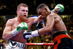 FILE - In this Saturday, May 4, 2019 file photo, Canelo Alvarez, left, of Mexico, fights Daniel Jacobs in a middleweight title boxing match in Las Vegas. Canelo Alvarez will fight Sergey Kovalev, Saturday, Nov. 2, 2019 at the MGM Grand in Las Vegas. (AP Photo/John Locher, File)