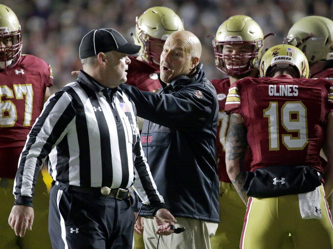 Boston College coach Steve Addazio, center, appeals to an official during the first half of the team's NCAA college football game against Clemson, Saturday, Nov. 10, 2018, in Boston. (AP Photo/Elise Amendola)