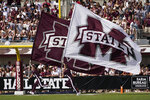 Mississippi State cheerleaders celebrate a first-half score by running through the end zone with the school's flags during an NCAA college football game against Louisiana Tech in Starkville, Miss., Saturday, Sept. 4, 2021. (AP Photo/Rogelio V. Solis)